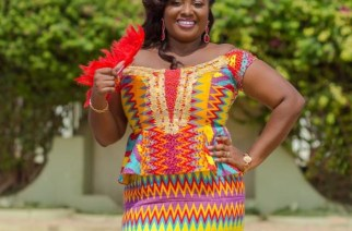 Mrs Christiana Abugah,looking beautiful in her off the shoulder kente outfit