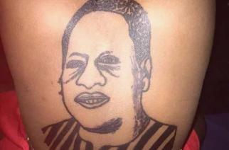 Woman Tattoos Former President John Mahama At Her back