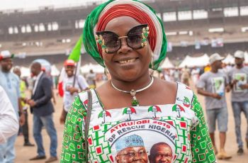 "Taiwo Kalejaiye travelled to the Lagos PDP rally from neighbouring Ogun state, wearing traditional Yoruba headgear, known is a ""gele"", in party colours.  ""Buhari's people don't love Nigeria, they love themselves,"" she says."