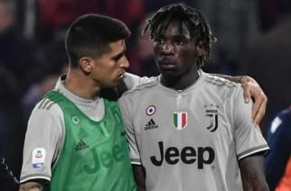 Juventus' Moise Kean (right) is comforted by team-mate Joao Cancelo