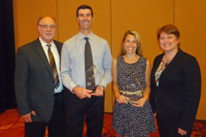 Award winner Scott and Amanda (middle) with Phil Lafontaine of CDE and Laura Henriques, CSTA president.