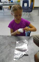 Kate, 3rd Grader, is experimenting and modifying her design.