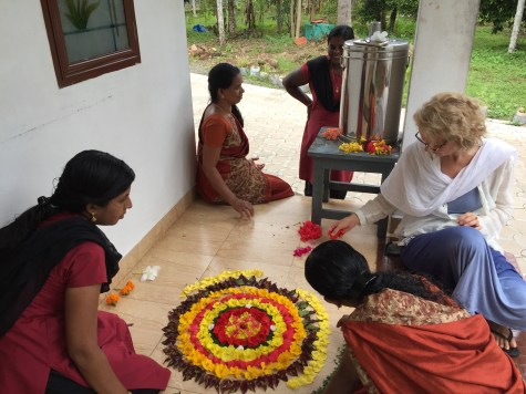 making flower mandalas for Onam in Kerala at the ayurvedic clinic Aatma