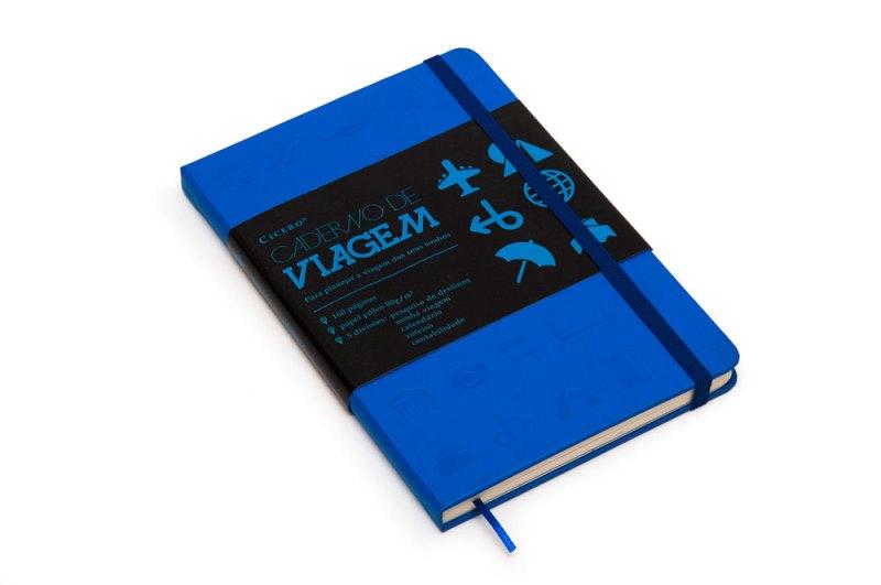 Caderno de capa azul estilo caderneta de anotações.