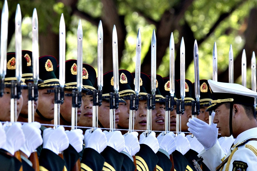 Members of a guard of honor prepare for a welcome ceremony for Pakistan Prime Minister Nawaz Sharif, unseen, outside the Great Hall of the People in Beijing, China, Friday, July 5, 2013. (AP Photo/Ng Han Guan)