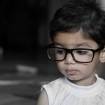 Child with Myopia wearing glasses