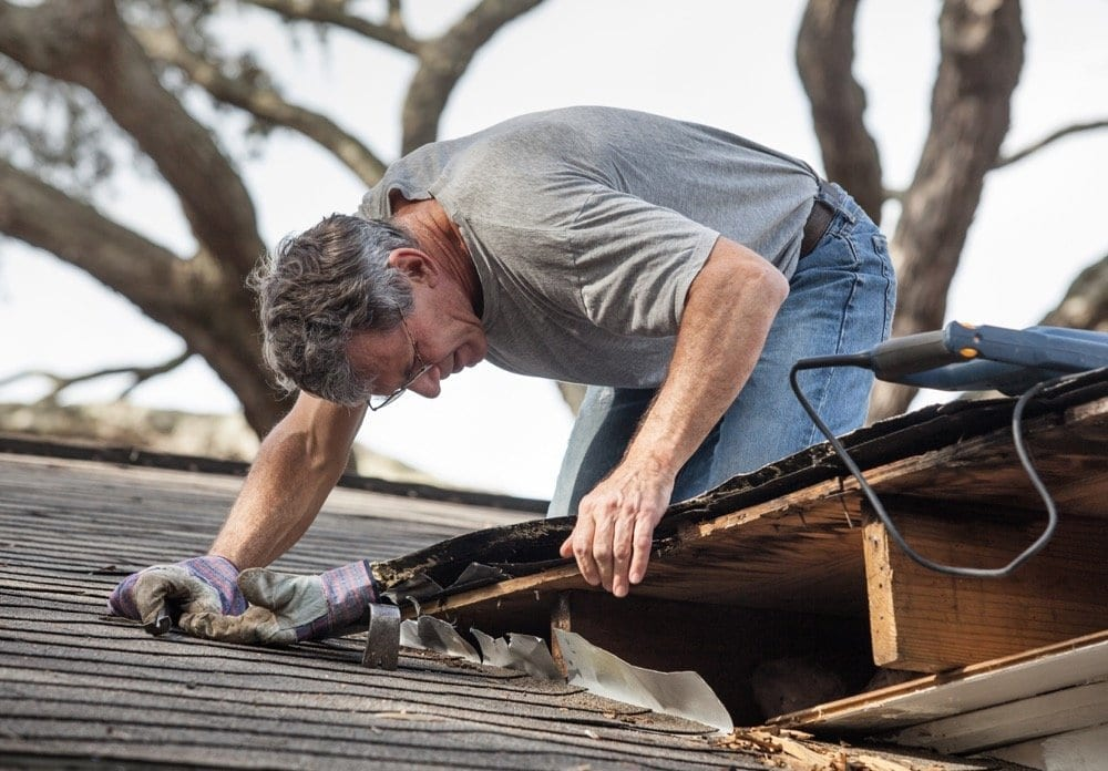 Calgary Roofing Companies | Claw Roofing Specialists Calgary Roofing Company - Claw Roofing - Home onwer inspecting shingle roof