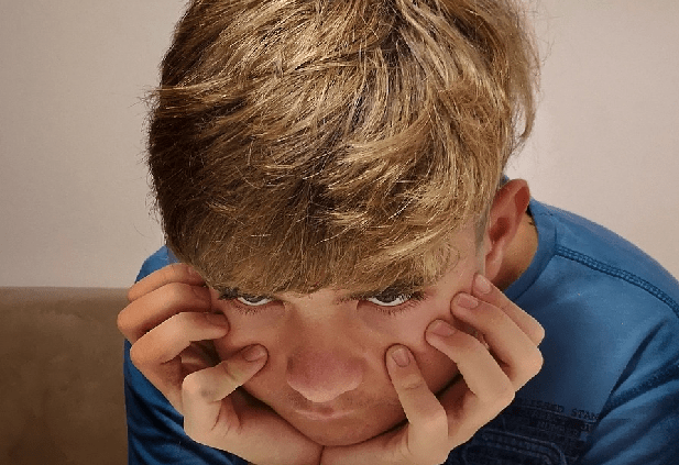 Photo of boy frustrated from studying