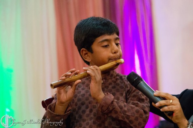 boy playing wooden flute