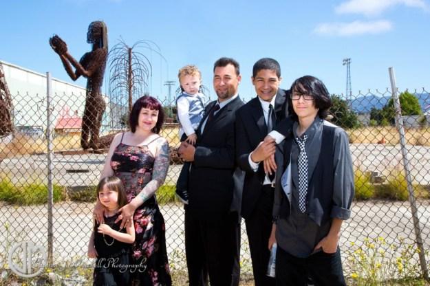 family portrait behind American Steel Studios Oakland