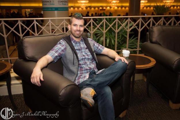 stylish man sitting in hotel lobby