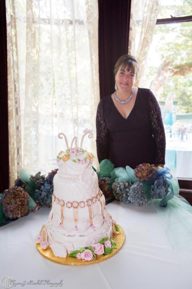beautiful wedding cake and its creator