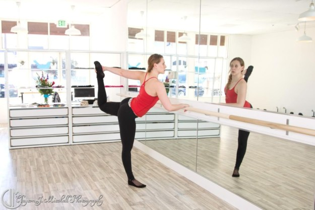 dancer reflected in the mirror at the barre