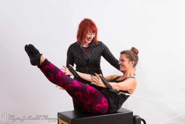pilates student and instructor photograph