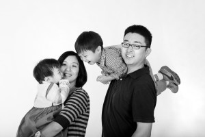 Playful asian family in studio black and white