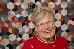 Grandma smiling with quilt background