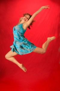 Dancing jump shot Senior Portrait on Red