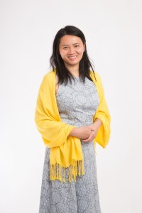 Asian woman with yellow scarf on white