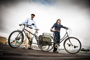 Couple stands proudly with their bikes