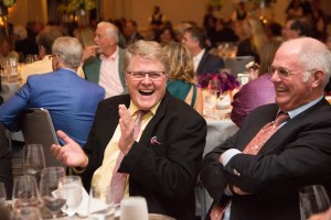 Businessman laughing at a fundraiser