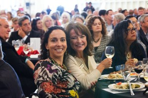 Two women toast at Alameda Chamber event