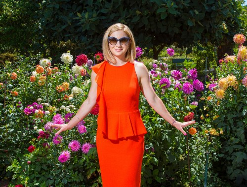 Dainty pose with Dahlias in a Garden