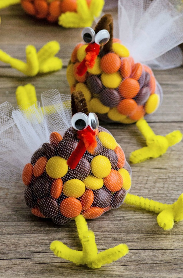 Turkey treats for Thanksgiving made with M&Ms, pipe cleaners, and tulle.