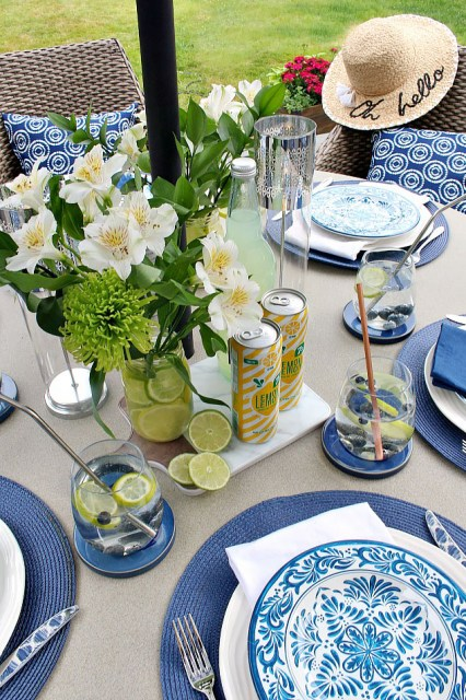 Beautiful summer tablescape with blues, yellows, and greens.