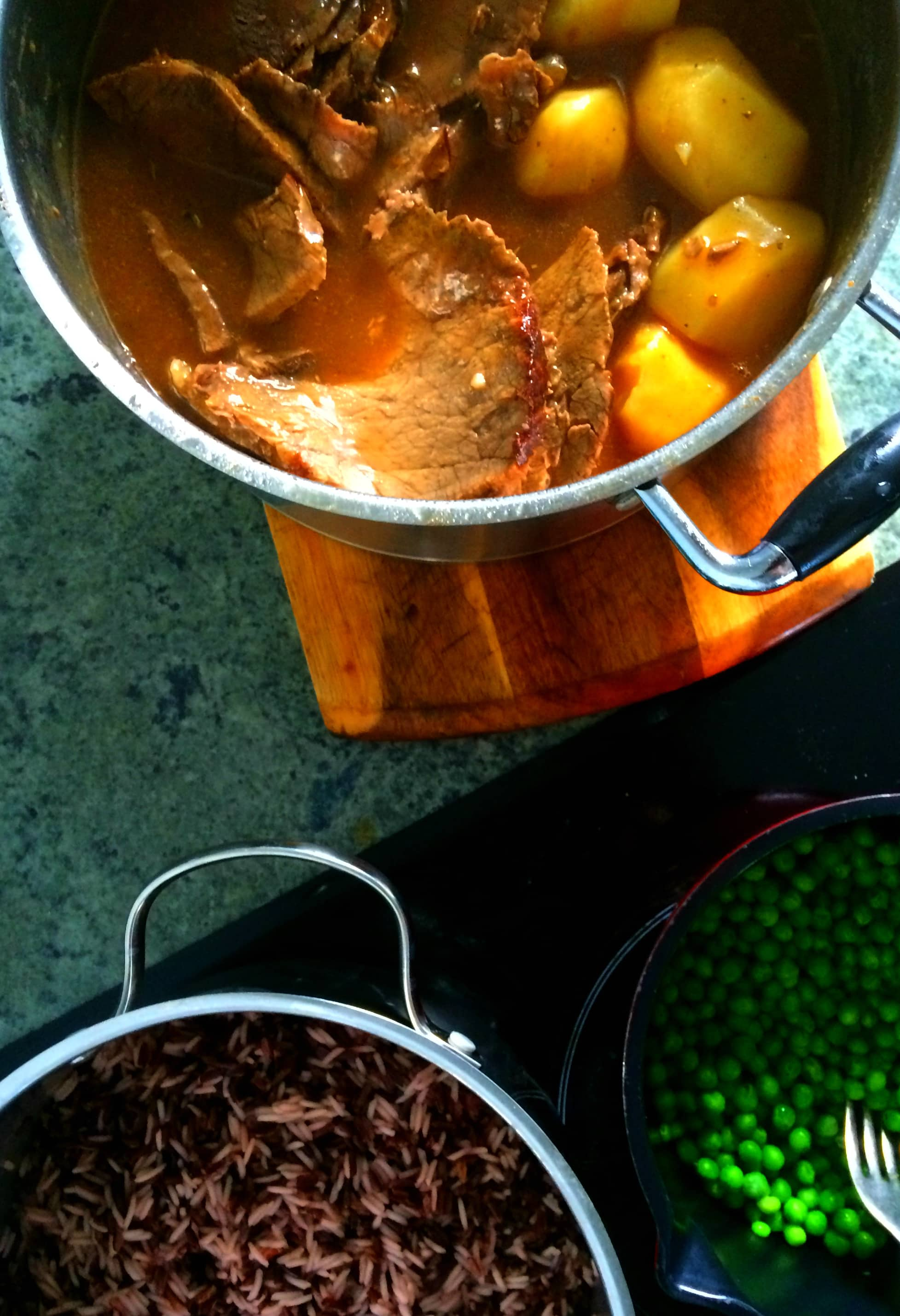 Family favorite - beef pot roast with buttered peas and domino rice.