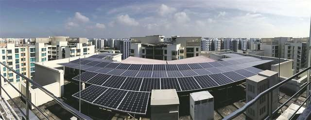 Solar panels on HDB rooftop in Singapore