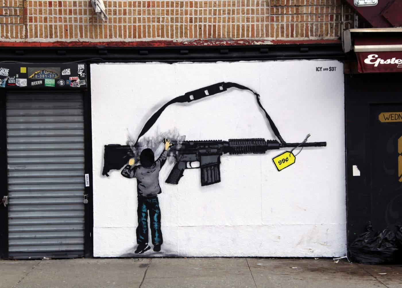jongetje veegt geweer uit