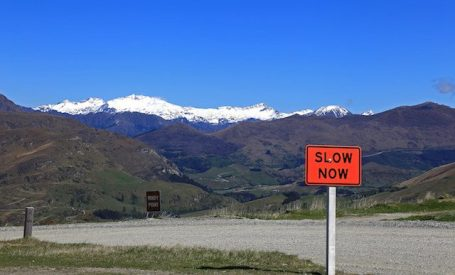 slow now sign on mountain pass