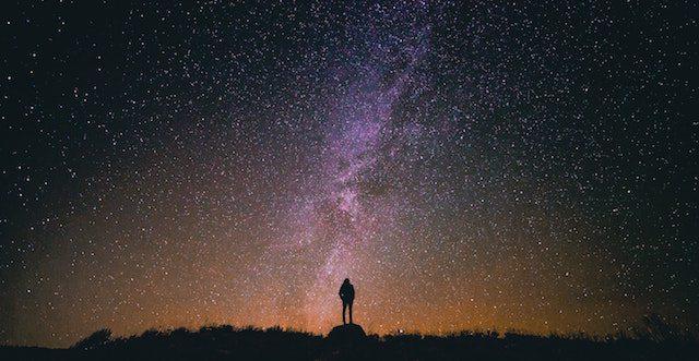 Man looking at stars