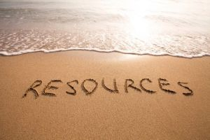 The word resources written in sand