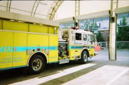 3 door bay for yellow firetrucks in a white fabric structure