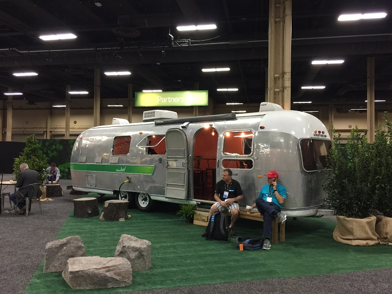 A trailer sits within Cisco Live. Customized for the conference.