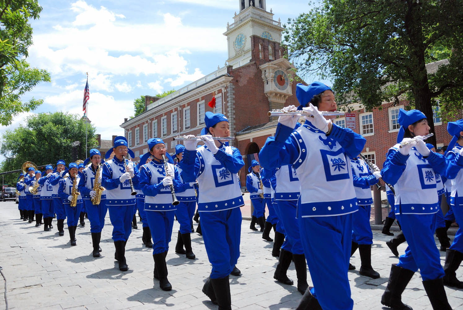 The Divine Land Marching Band participates in the celebration of the 233th birthday of the America. The band members march in front of the Independence Hall.