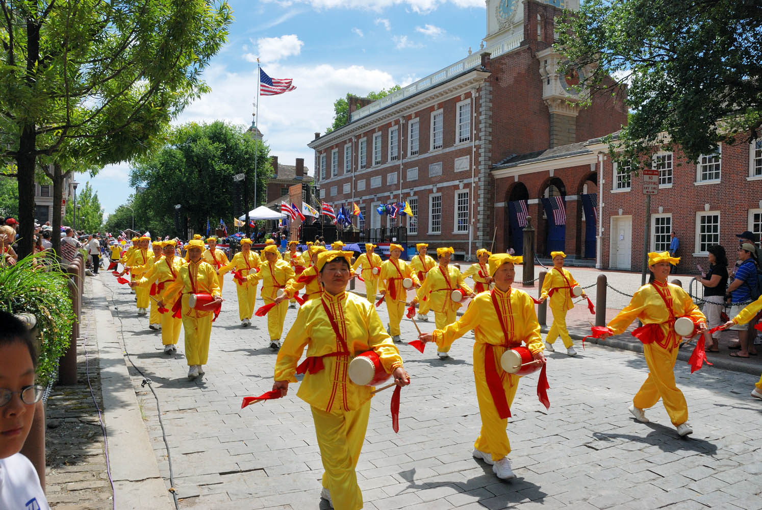 The Falun Dafa Waist Drum Team participates in the celebration of the 233th birthday of the America. The members march in front of Independence Hall.