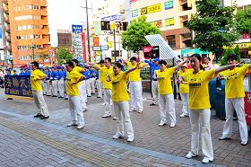 Demonstrating exercises in front of a train station in Kobe