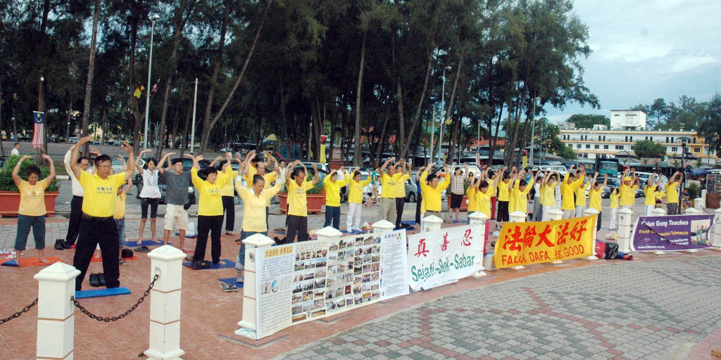 Falun Gong practitioners do the exercises near the seaside in Port Dickson before the Malaysian Independence Day