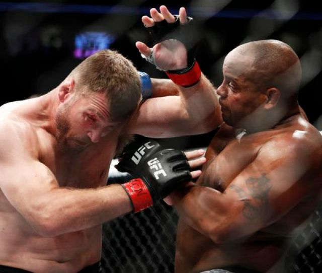 Daniel Cormier Right Fights Stipe Miocic During A Heavyweight Title Mixed Martial Arts Bout