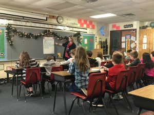 5th graders seated in a creative writing class.