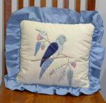 Hand-appliqué parrot cushion by Dione Gardner-Stephen