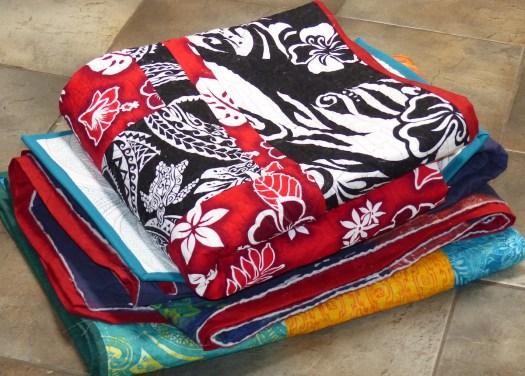 quilt pile needing quilt labels