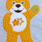 Yellow-orange bear appliqué from Clever Chamaleon