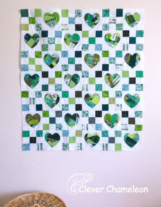 Green Hearts 4 Christchurch quilt. Green nine-patch quilt with pieced appliqué hearts at Clever Chameleon.