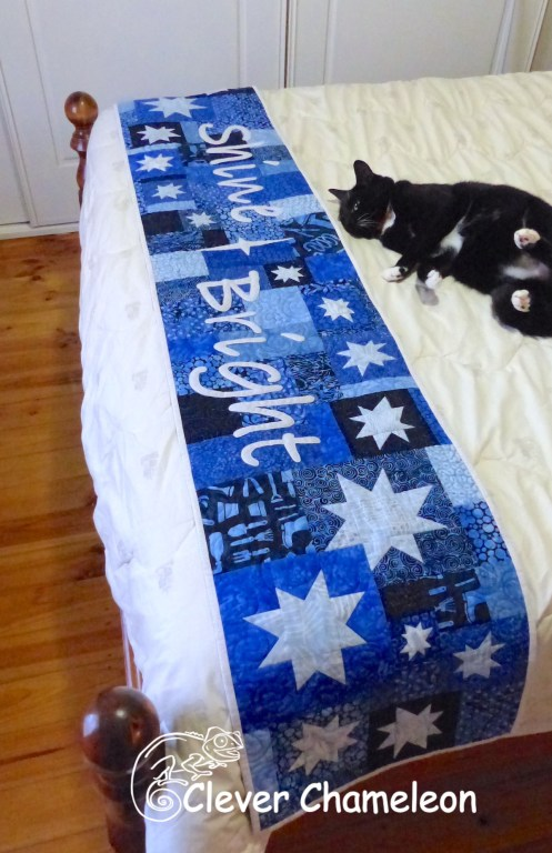 Shine Bright quilt as a bed runner at Clever Chameleon