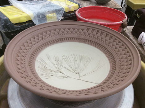 bowl by Liz Hyde show pine needles impressed in clay