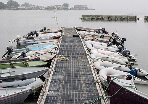 Photograph of dinghies by Nancy Rich