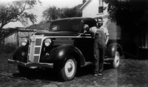 Grandpa Dersch as a young man, standing proud with his '37 GMC half-ton pickup.
